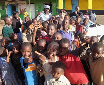 Nelly and volunteers with the Chebagogo kids in Kenya.